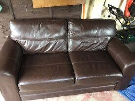 Two seater brown leather sofa in good condition.