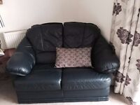 Navy blue leather three seater sofa two seater sofa and reclining chair.