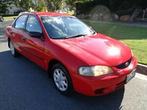 1998 Ford Laser KJIIL GLXi Red 4 Speed Automatic Sedan Chermside Brisbane North East Preview