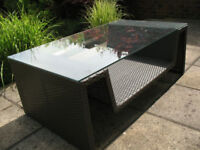 A Large Glass/Rattan Style Coffee Table