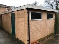 Garage with electric roller door. Needs dismantling