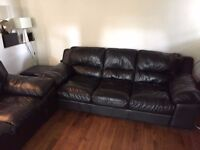 black leather 5 seater sofas and puffet bargain price