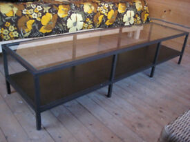 Coffee Table - steel frame, glass top and wood shelf in a very good condition