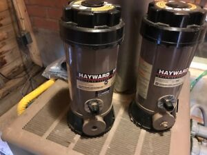 Two Hayward Chlorine Puck Feeders for in-ground pools. Model CL2