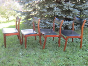 Four mid century teak dining chairs