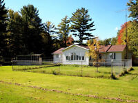 4.53 ACRE PRIVATE YEAR-ROUND BUNGALOW WITH 3 CAR GARAGE