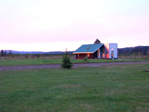 20 min. West of town luxurious cottage on large property
