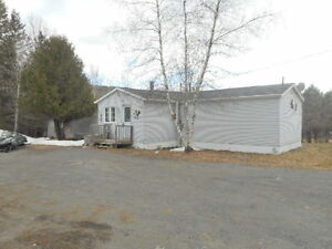 Only min. from city, mini home on your own 1 acre lot!