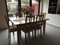 Wooden extending dining table with 6 chairs