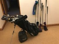 Set of golf clubs with accessories