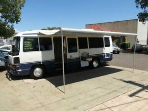 1991 Toyota Coaster Deluxe (LWB) White Bus 4.2l 4x2 Revesby Bankstown Area Preview