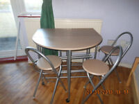 *******FOLDING DINING TABLE WITH WINE RACK AND 4 CHAIRS ON CASTORS*****