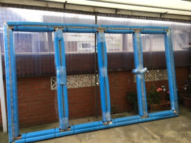 Brand new set of Bifold doors with glass for sale.