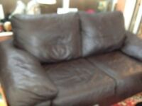 black leather 2 seater sofa bed + matching armchair from hopewells nottingham.