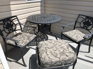 "Patio table 36"" round, 2 chairs, 1 ottoman, 3 cushions"