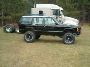 Flatbed Tow 1988 Jeep Cherokee from Dilworth to Orleans