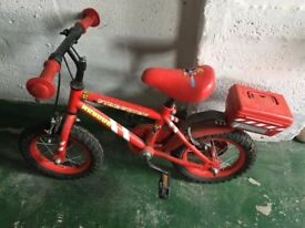 12 inch red fireman bike for sale