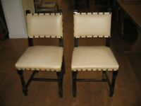 20 dining chairs wood framed seats and backs upholstered in plain cream. Used but generally sound