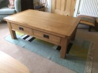 Solid oak coffee table with 4 drawers. Good condition.