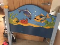 Kids bed - under the sea carvings on headboard. Good condition