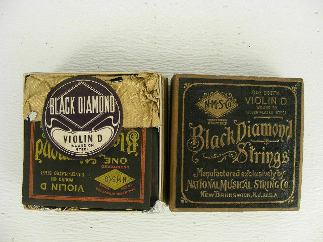 These are full boxes of 12 new old stock Black Diamond violin strings in D.