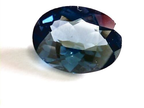 5.40 ct extreme rear Blue Masasi Garnet  color change ,very clear  ,oval cut