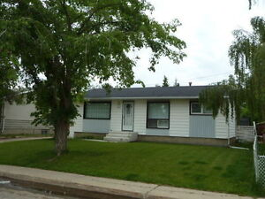 Many Updates 3 Bedroom and Den House, with Double Heated Garage