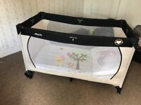 Travel cot with additional thick mattress