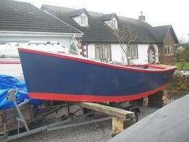 USA design 15 feet x 6 feet 8 inches transom stern dory with outboard well.