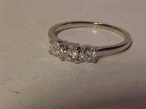 #890-*PAST*PRESENT*FUTURE* DIAMOND(.53ct.)14k WHITE GOLD ENGAGEMENT RING-Size 7-APPRAISED VALUE-$1,800.00-Yours-$545.00