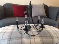 Wrought iron ceiling light with five candle lights