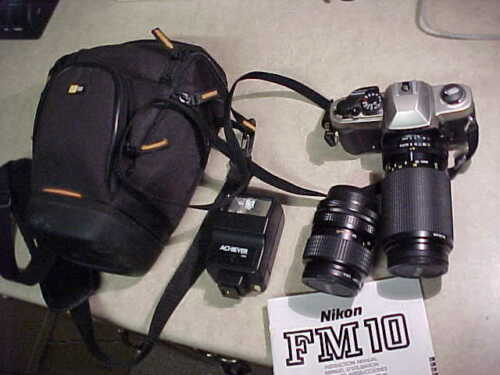 Very nice Nikon FM 10 SLR 35mm Camera with extra lens, carry case, etc-estate