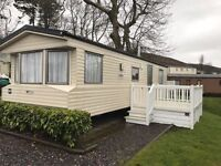 Static Caravan for Sale in North Wales-sited on Stunning duck pond-sleeps 6 people -decking included