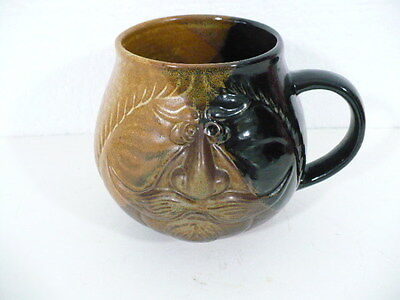 "Pottery face mug with great expression  4-1/2"" tall"