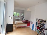 Lovely large bright and sunny fully self contained studio flat. All bills included and free WIFI.