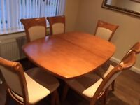 Extending hardwood dining table and 6 matching chairs - very good condition