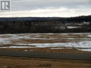 Water front lot with great views, 10 min to Sussex, 5.25 acres!!