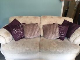 Good Condition 3 Seated White Sofa With Poof Plus Purple Throw & Purple Cushions