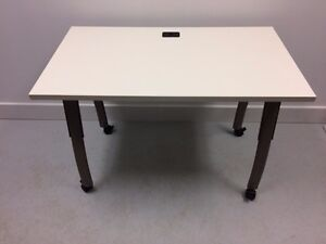 8 mobile Teknion tables for sale with adjustable legs