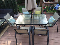 Outdoor patio dining table, (6) chairs, and umbrella for sale