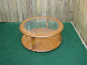 Round coffee table with glass display