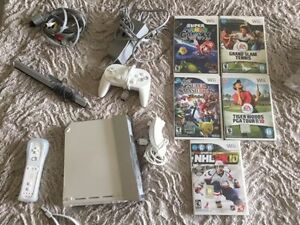 Selling or Trading my Nintendo Wii with games.