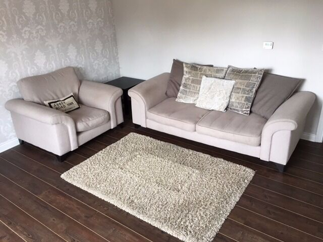 Nice large sofa and arm chair with cushions included