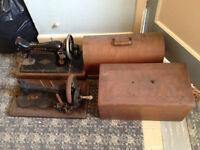 2 Vintage Singer Sewing machines in Original Carry Boxes.