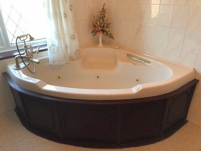 Bathroom suite -any offer - whirlpool bath with jets - good working motor - peach colour
