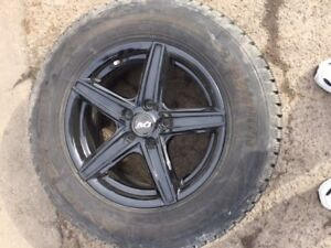 4 WINTER TIRES ON ALLOY RIMS