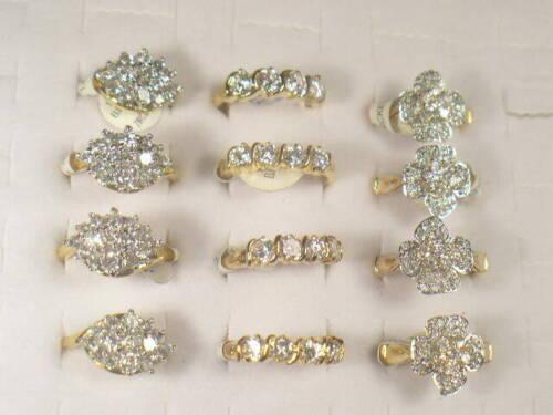 12 .. CZ  RINGS  VINTAGE  WITH SIMULATED  DIAMOMD SWAROVSKI CZ