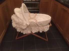 Mothercare unisex moses basket and stand. Good condition. All fabric removable and machine washable.