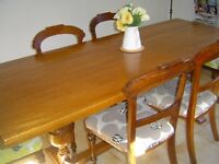 SOLID OAK ANTIQUE TABLE AND SIX CHAIRS