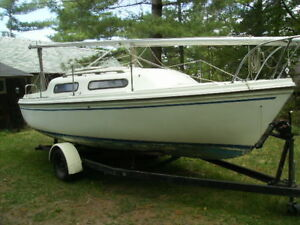 Sirius 21 sailboat with outboard and trailer